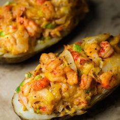 Crawfish Stuffed Potatoes Prep time: 30 min Cook time: 120 minutes Total: 2 hours and 30 minutes Serves 4 2 large russet potatoes, 1 tbsp olive oil, 1 stick unsalted butter, 1/2 cup diced yellow onions, 1/2 cup diced celery, 2 tbsp diced green onion tops, 1 tsp minced garlic, 1 tbsp cajun seasoning, dash of hot sauce, kosher salt and freshly ground black pepper, 1 lb Louisiana crawfish tails, 1 cup shredded cheddar cheese, 2 tbsp sour cream