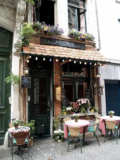 Cafe in Antwerp, Belgium. I can totally see myself sitting here on a crisp morning with a hot cup of coffee and fresh pastry Un Joli Café by nirantara, via Flickr