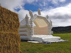 white wedding bouncy castle and hay bales, £120