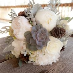Gorgeous Rustic Winter Wedding Bouquet filled with succulents, peonies, dusty miller and more.
