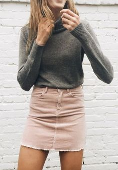 blush denim miniskirt, graphite brindle turtleneck w/ ribbed collar & cuffs, lightly tanned skin, smile, shoulderlength amber locks