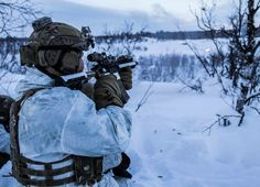 Air Force SOF provide support by fire for a simulated assault during Arctic winter training near Kiruna Sweden