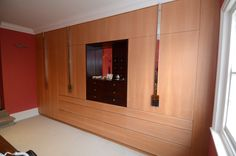 Dressing room wardrobes and drawers made from solid and veneered Cedar of Lebanon and mahogany / bespoke nickel plated handles and drawers with flush handles/ 9 small drawers made of mahogany / 6 false drawers which open as 2 cupboard doors / jib mirror to cupboard