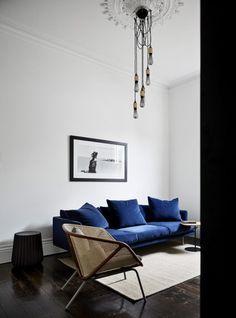 Blue Velvet Sofa via Taylor Knights decor blue sofa 25 Stunning Living Rooms with Blue Velvet Sofas