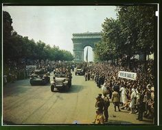 Crowds of French patriots line the Champs Elysees to view Allied tanks and half tracks pass through the Arc du Triomphe after Paris was liberated on August 25 1944 (LOC)