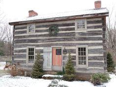 Rustic Log Cabin...pine trees, wreaths, &...flag on the front door.