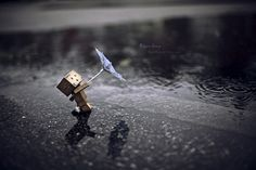 ImageFind images and videos about rain, umbrella and danbo on We Heart It - the app to get lost in what you love. Danbo, Box Robot, Amazon Box, Lit Wallpaper, Cute Box, Cute Photography, Blown Away, Dancing In The Rain, Little Boxes