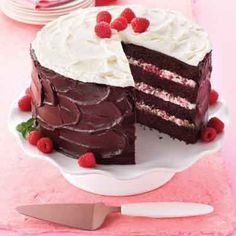Elevate chocolate cake, raspberries and whipped cream to new heights in this 4-layer torte.