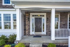 Beautiful new model home. Stone siding, front porch, brown door. This is the Rosecliff II at Maple Valley Estates by Dan Ryan Builders. Home Style Ideas