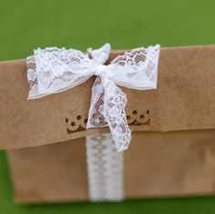 A bit of lace and a scalloped-edge paper punch transform a boring bag into an adorable idea for packaging holiday cookies or candies. #lace #gift bag