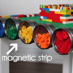 DIY lego table with magnetic strip on one side and hanging buckets on the other side.  (Uses gorilla glue to glue the base plates down to the table.)