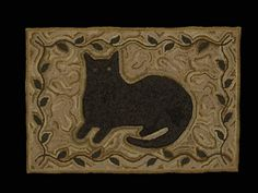 black cat rug (need to hook one in memory of my Suzy)