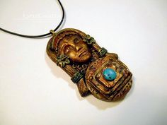 Spirit of the Mayan Dancer gold & turquoise polymer clay and resin jewelry pendant necklace handmade One of a Kind by LynzCraftz on Etsy