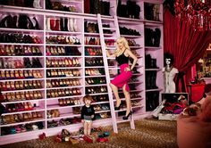 "Christina Aguilera has not one but two expansive closets. First stop: Shoes. ""Everything on my shoe wall is grouped by designer—Louboutin, McQueen, YSL—all in their own little family,"" says Aguilera. ""And there's room for boots up top."" The hyper-organized singer also has zones for her jeans, jackets, coats, skirts, sweaters and jewelry in the ultra-glam room, complete with a chandelier and leopard-print rug."