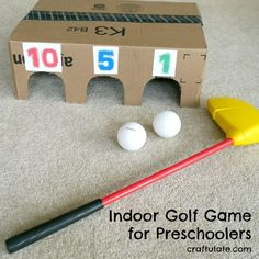 This indoor golf game is made from a cardboard box and works on both gross motor skills and addition!