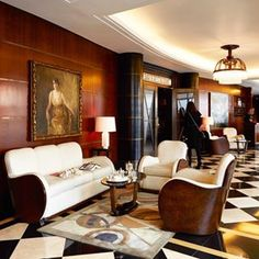 The art of deco design. In @thebeaumontldn's clubby, intimate lobby, elegant wood paneling, black-and-white checkered marble floors, Deco details and vintage portraits lend a sense of history. #artdeco #london #design #envygram