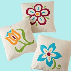 Make pillow covers from drop cloth and personalize them with floral designs. Our free stencils make it an easy project you can complete in just a few hours.