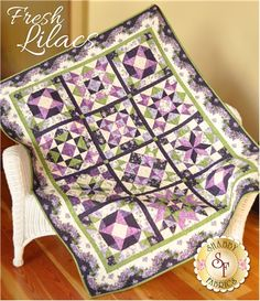 Fresh Lilacs Full Kit: This beautiful design features the Fresh Lilacs collection by Maywood Studio. Finishing to 50 x 63, this stunning quilt features basic piecing but will wow your guests with its complex look! Includes the patterns, all fabrics to complete the top of the quilt including sashing, borders, and binding. Backing available separately.