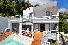 Overlooking the four beaches at Clifton with sublime sea views. Large family home mountain side of Victoria Road with garaging and elevator access. lounge dining room flowing to patio and pool. 3 Bedrooms main en suite plus family bathroom. A separate 1 bedroomed flatlet and separate guest suite. Total of 5 bedrooms