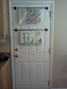 Magnetic Curtain Rods Used To Hold Artwork On Metal Door