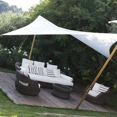 If you need privacy from above, a simple shade sail can be bought or made and installed to provide respite from the midday sun, and give you privacy from units above. You can make a shade sail out of Backyard Shade, Outdoor Shade, Patio Shade, Pergola Shade, Shade Garden, Backyard Patio, Outdoor Areas, Outdoor Rooms, Outdoor Living
