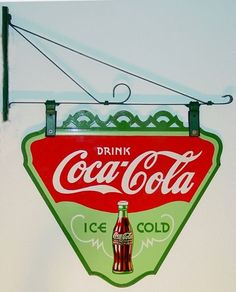 RARE 1930s Coca-Cola Porcelain Triangle Sign. One Of The Rarest Porcelain Signs. Double-sided. With original hanging bracket. Measures 24-1/2″ W x 22″ H.