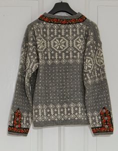 Norwegian knit sweater by FineLIttleDay on etsy.  Interesting use of the embroidered trim.