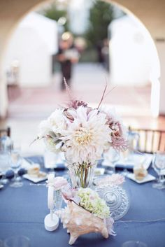 conch shell used as a planter in this beach wedding centerpiece