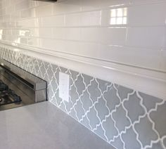 Backsplash in my new kitchen. Subway tiles and arabesque tile.