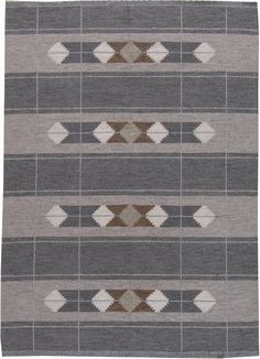 A mid 20th Century Swedish Flat Weave Rug with a layered design. A silver linear grid overlaps a diamond motif on a striped field of dark gray and light gray.