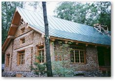 """Cordwood Masonry - Cordwood masonry or what is sometimes called """"stackwall"""" or """"stovewood"""" is a form of house construction that consists of laying whole or split wood, width-wise in a bed of mortar. When looking at a cordwood wall, log ends are the only part of the wood that are visible."""