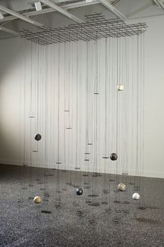 """Pamela J. Wallace, Elegy 2006 11' x 5'6"""" x 9' (or height of ceiling). steel, plaster, pigment, waxed cord"""