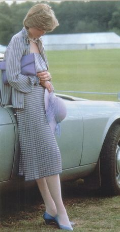 Lady Diana casually leans against Prince Charles Aston Martin while he plays polo (6-16-1981)