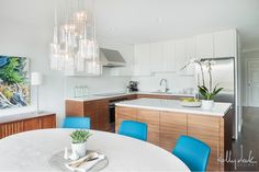 white, wood, warm grey tile floor, white marble accent. white solid surface counter and backsplash