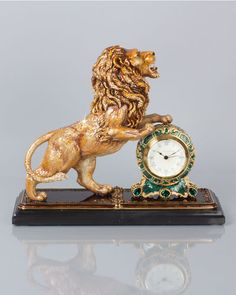 Jay Strongwater majestic lion clock on marble base hand enameled and hand set with Swarovski crystal