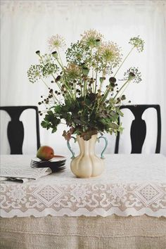 """casual country Swedish flower arrangement: """" seed heads of poppies and allium together with weeds from the field """""""