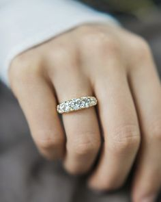 The June ring is an Antique Engagement Ring from the Victorian Era circa 1890! This 5 stone ring centers an old European cut diamond weighing approximately 0.60 carats of J-K color, I1 clarity. To each side of the central stone is an additional old European cut diamond weighing about 0.39 carats followed by a 0.25 carat OEC. The diamonds are highlighted by eight rose cut diamonds placed between the 5 main diamonds. The total carat weight for the ring is about 1.92 carats.