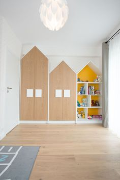 The handles on these house-shaped closet double as 'windows' and help to create a fun space for the child, but as they are larger than normal hardware found on cabinets, it also makes it easier for the child to open their closet. Boys Bedroom Furniture, Retro Furniture, Sofa Furniture, Cheap Furniture, Furniture Cleaning, Furniture Market, Furniture Movers, Discount Furniture, Luxury Furniture