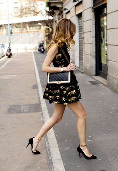 gold & black is a great combo, but how cute is the quirky animal print dress paired with the classic heels & bag!
