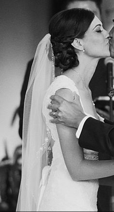 I like this veil/hair combo but with a French braid to the side instead of just a big knot...
