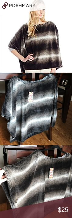 Dylan Faux Fur Poncho Super soft ladies Dylan faux fur poncho. Will give you a cute, stylish look while keeping you nice and warm. Medium/Small size. New, never worn. Very nice quality. Sweaters Shrugs & Ponchos
