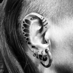 ear tattoo with Nordic patterns by Peter Madsen