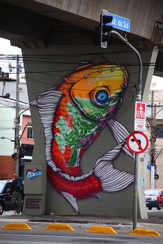 Sao Paulo, Brazil     58 street artists painted 77 walls below the train line at Santana station, Sao Paulo and created the first street art open air museum (MAAU), at the initaitive of street artists Chivitz and Binho.