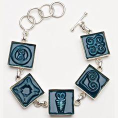 Handmade Adinkra tiles in an adjustable, silver-plate bracelet setting. (Photography by Rat Race Studios)
