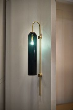 Float is a minimalist light from Articolo that's reminiscent of Hollywood glamour with sleek, elongated proportions, striking colored glass and brass stems.