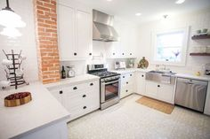 How adorable is this brick home?! My favorite touches include the exposed brick in the kitchen and the french inspired style on the exterior. The walls remain soft whites and greys to allow for plenty of pops of color through the accessories. All pictures found here All pictures found here
