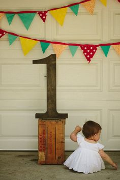 Wooden 1 and flags made for Sophia's Rio themed party Sophia Araujo Turns 1 Photo By Tori Pintar Photographer