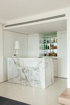 Gallery | Australian Interior Design Awards. Marble cocktail bar. White timber panelling.