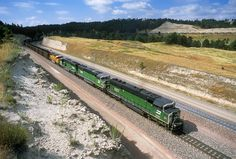 https://flic.kr/p/STt4eh | Green thunder | Three Cascade green SD60Ms shove on the rear DPU of a loaded Burlington Northern Santa Fe coal train climbing Crawford Hill below Belmont, Nebraska. It may be dry and turning gold on the hills, but at least there's still green thundering on the rails on July 22, 2003.