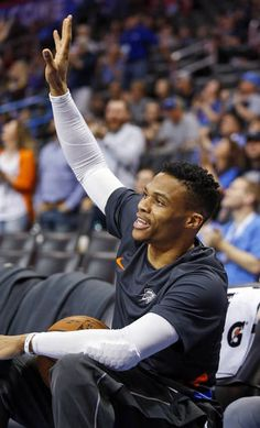 Oklahoma City's Russell Westbrook (0) waves to fans as the public address announcer talks about Westbrook reaching his 100th career triple-double, before an NBA basketball game between the Oklahoma City Thunder and the Los Angeles Clippers at Chesapeake Energy Arena in Oklahoma City, Friday, March 16, 2018. Photo by Nate Billings, The Oklahoman